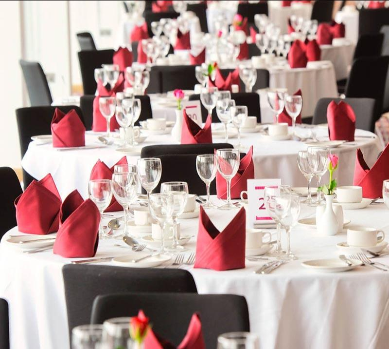 A beautifully prepared set of tables in white and rose.