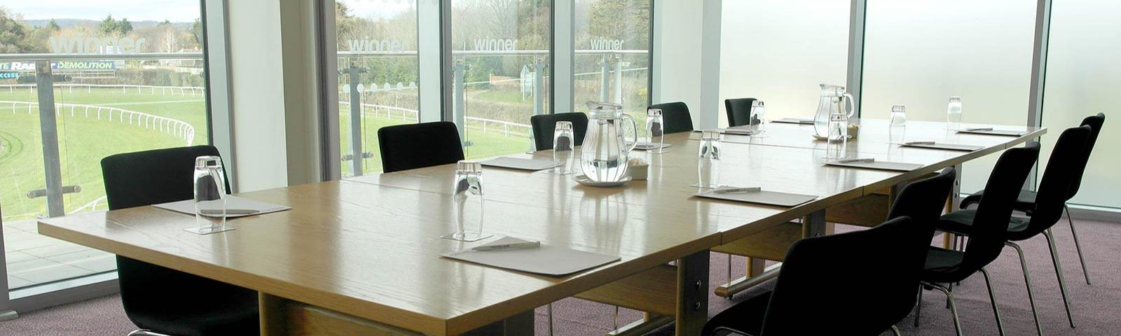 Close up a table set up for a meeting inside a private room at Fontwell Park Racecourse.