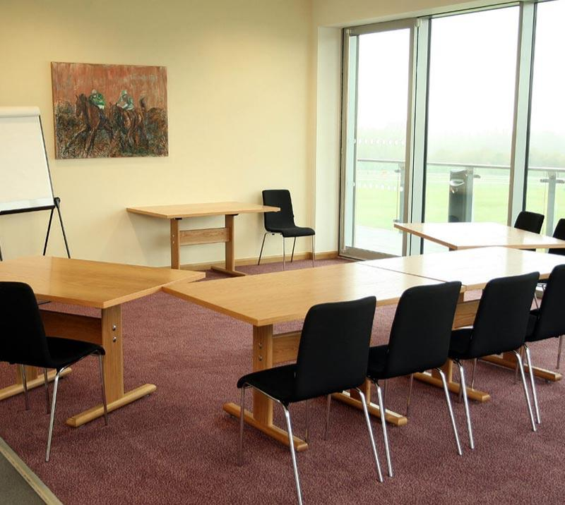Tables set up for a meeting inside a private room at Fontwell Park Racecourse.