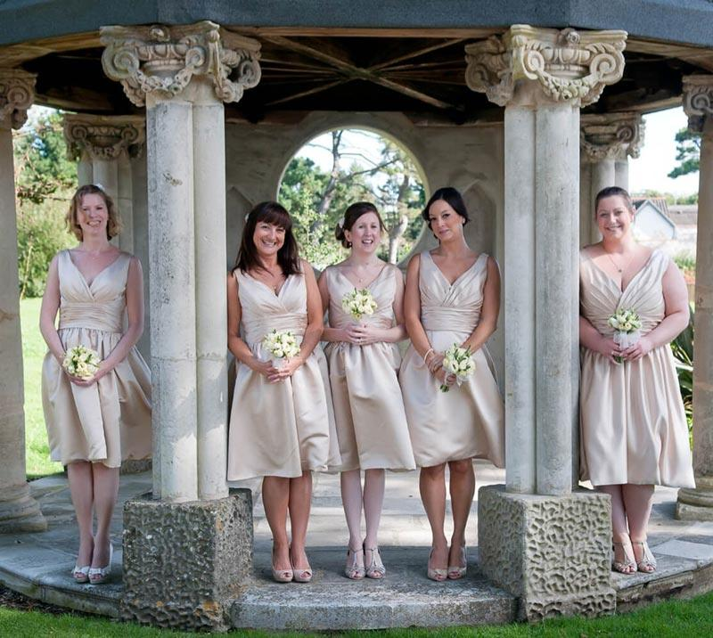Bridesmaids posing for the photographer in the grounds of Fontwell Park Racecourse.